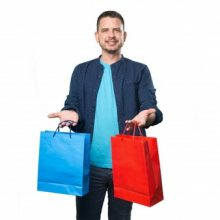 young-man-wearing-a-blue-outfit-holding-shopping-bags_1298-166